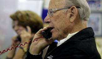 Sen. Pat Roberts, R-Kansas, makes a call to a prospective voter at the Kansas Republican Party headquarters, Tuesday, Nov. 4, 2014, in Topeka, Kansas. Incumbent Roberts is locked in a tough contest with independent candidate Greg Orman. (AP Photo/Charlie Riedel)