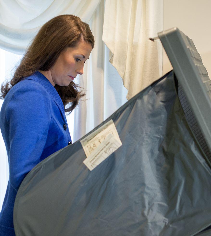 Democratic U.S. Senate candidate Alison Lundergan Grimes votes Tuesday Nov. 4, 2014, at the The Peasant Green Baptist Church in Lexington, Ky.   (AP Photo/ John Flavell)