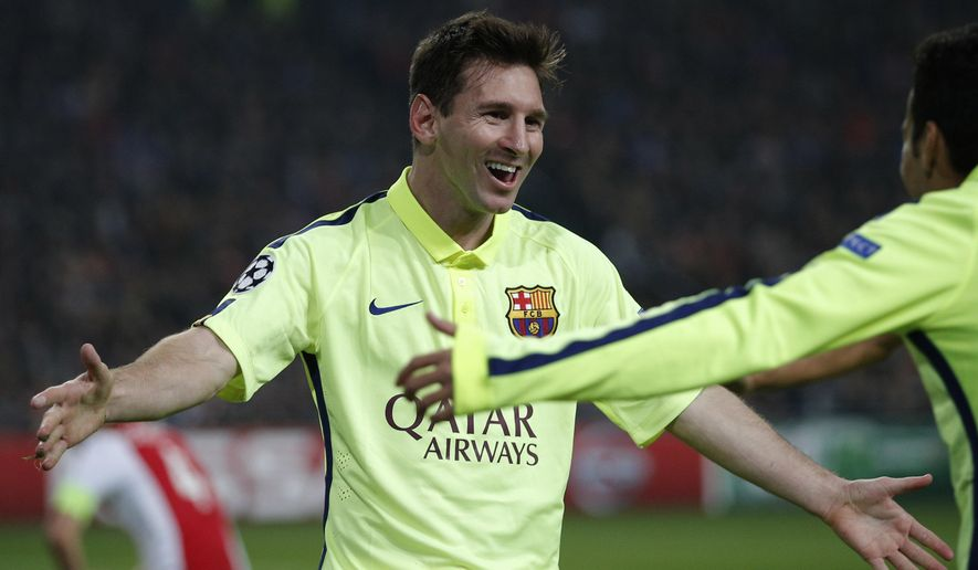 Barcelona's Lionel Messi celebrates scoring his side's 2nd goal during the Group F Champions League match between AFC Ajax and FC Barcelona at ArenA stadium in Amsterdam, Netherlands, Wednesday, Nov. 5, 2014. (AP Photo/Peter Dejong)