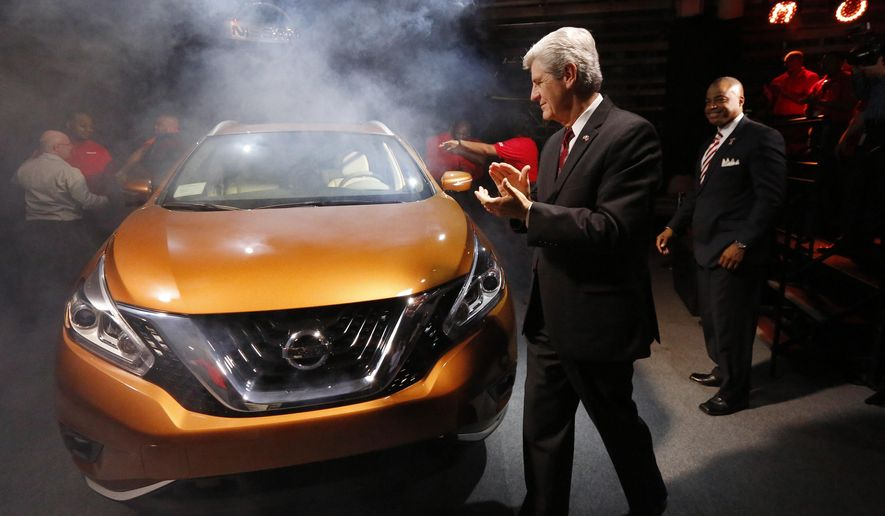 Mississippi Gov, Phil Bryant inspects the newly unveiled 2015 Nissan Murano, a crossover vehicle that will be exclusively manufactured at the Nissan plant in Canton, Miss., beginning with the 2015 line, Wednesday, Nov. 5, 2014. Nissan Motor Co. says it wants to produce more than 500,000 vehicles at the plant by 2017, an expansion that would add about 1,000 employees to the current 6,300 workers at the complex. (AP Photo/Rogelio V. Solis)