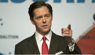Ralph Reed, founder and chairman of the Faith & Freedom Coalition, told a Washington, D.C. audience on June 10 that November's election is too important for evangelical Christians to sit out. In this file photo, Mr. Reed is shown at a 2014 Faith & Freedom Coalition event. (Associated Press) **FILE**