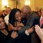 Republican Mia Love celebrates with her father, Jean Maxime Bourdeau, after winning the race for Utah's 4th Congressional District during the Utah State GOP election night watch party, Tuesday, Nov. 4, 2014, in Salt Lake City. Love becomes first black female Republican elected to Congress. (AP Photo/Rick Bowmer)
