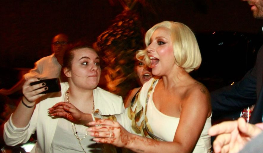 Lady Gaga arrives at the Ritz-Carlton hotel in Herzeliya near Tel Aviv, Israel, Friday, Sept. 12, 2014. She has arrived in Israel for a concert on Saturday, according to her website. Her first concert on this tour in the region was in Dubai on Wednesday. (AP Photo/Amir Meiri) ISRAEL OUT