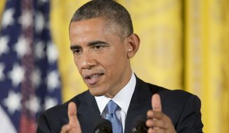 President Obama is under pressure from pro-immigration groups to halt deportation of illegal immigrants and grant them some form of legal status. (Associated Press)