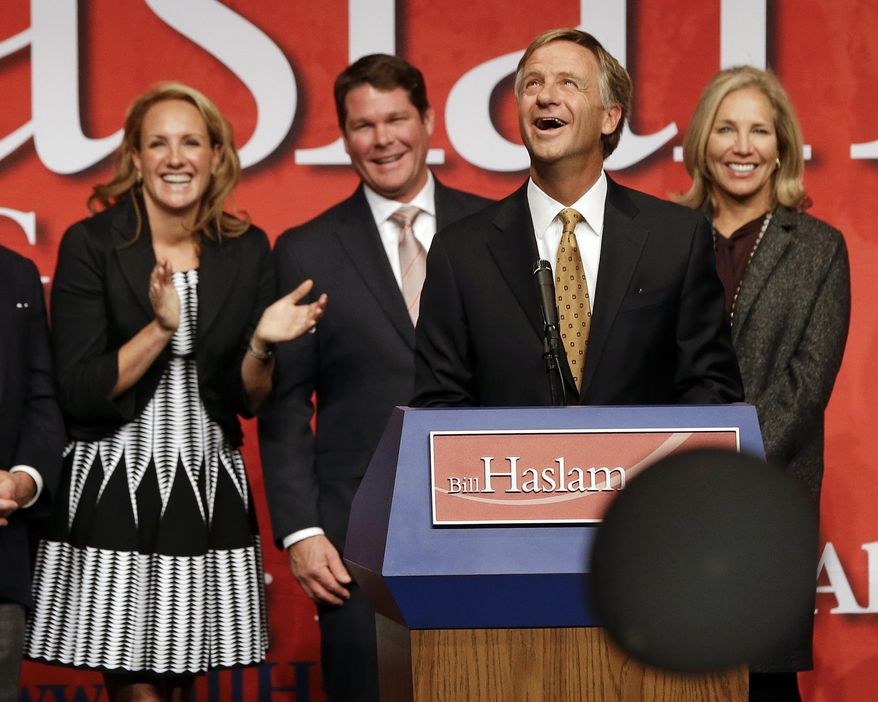 After being re-elected, Tennessee Gov. Bill Haslam watches as balloons begin to fall after he spoke to supporters in Nashville, Tenn., Tuesday, Nov. 4, 2014. (AP Photo/Mark Humphrey)