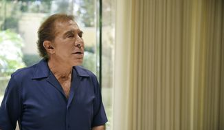 "In this Friday, Oct. 31, 2014 photo, Casino mogul Steve Wynn speaks about his upcoming musical ""ShowStoppers,"" at his office in Las Vegas. Wynn's ""ShowStoppers"" will take 20 of Broadway's most memorable songs, a list likely to rotate as producers see fit, and present them in a way that explains what sets them apart. (AP Photo/John Locher)"