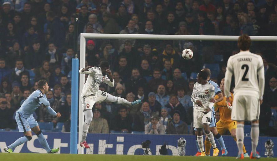 CSKA's Seydou Doumbia scores the opening goal, during the Champions League group E soccer match between Manchester City and CSKA Moscow, at the Etihad Stadium, in Manchester, England, Wednesday, Nov. 5, 2014. (AP Photo/Jon Super)