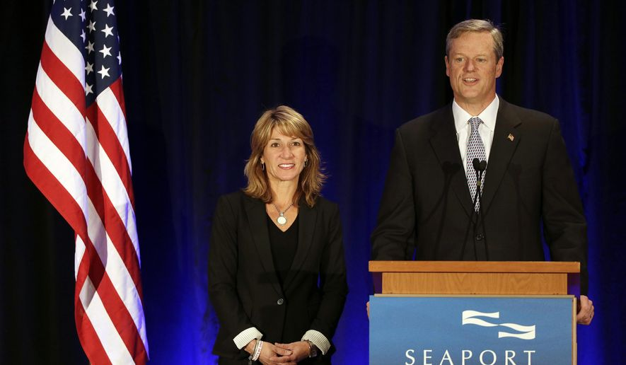 Massachusetts Governor-elect Charlie Baker, right, addresses reporters as his running mate, Lt. Gov.-elect Karyn Polito looks on, during a media availability after Attorney General Martha Coakley, the Democratic gubernatorial candidate conceded in a close race Wednesday, Nov. 5, 2014, in Boston. Baker became the state's first Republican governor since Mitt Romney left office in 2007. (AP Photo/Stephan Savoia)