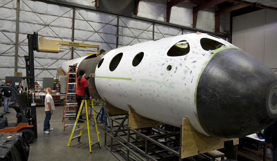 FILE - This undated file photo, first released in 2008 by Virgin Galactic, shows SpaceShipTwo's construction inside the Scaled Composites plant at the Mojave Airport in Mojave, Calif.  The head of the space tourism company that suffered a tragic setback when its experimental rocket ship broke apart over the California desert says test flights could resume as early as next summer. Virgin Galactic CEO George Whitesides told The Associated Press on Wednesday, Nov. 5, 2014 that work is underway at the company's Mojave shop to finish a second spacecraft. It will replace the first SpaceShipTwo, which was destroyed last week when it disintegrated during a test flight, killing one pilot and seriously injuring another.(AP Photo/Virgin Galactic, File)  NO SLALES