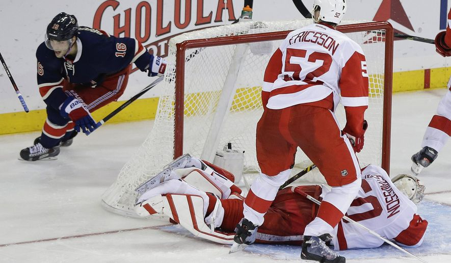 New York Rangers' Derick Brassard (16) celebrates as Detroit Red Wings goalie Jonas Gustavsson (50), of Sweden, reacts after Brassard scored a goal to win during the overtime period of an NHL hockey game Wednesday, Nov. 5, 2014, in New York. The Rangers won the game 4-3. (AP Photo/Frank Franklin II)