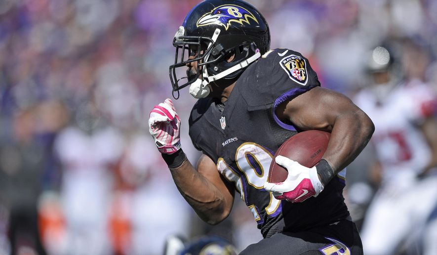 """FILE - In this Oct. 19, 2014, file photo, Baltimore Ravens running back Justin Forsett carries the ball in the first half of an NFL football game against the Atlanta Falcons in Baltimore. Forsett got his chance when Ray Rice got cut for his domestic violence case. """"He's got great vision, is very elusive and hard to tackle,"""" Baltimore coach John Harbaugh said. (AP Photo/Nick Wass, File)"""