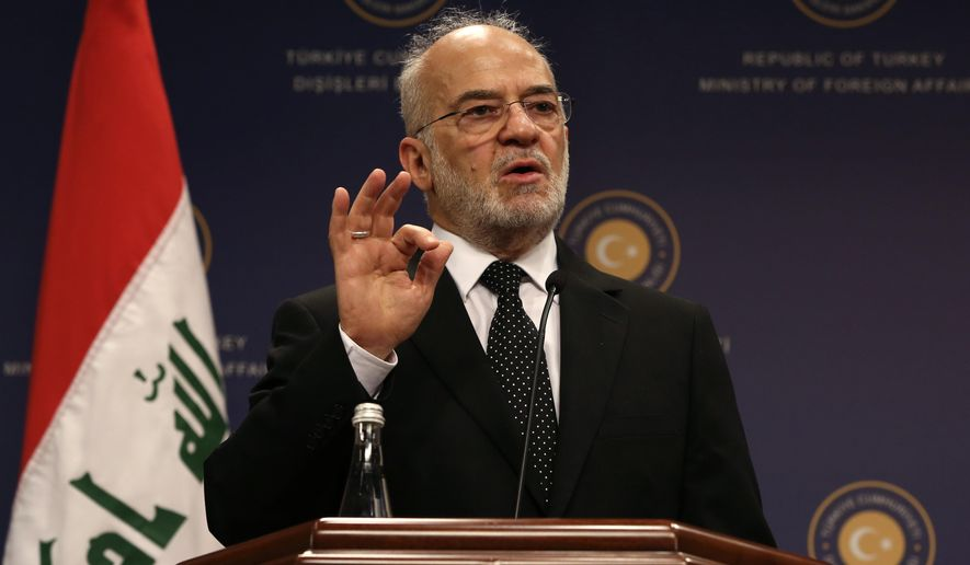 Iraqi Foreign Minister Ibrahim al-Jafari speaks to the media during a news conference with his Turkish counterpart Mevlut Cavusoglu after their talks in Ankara, Turkey, Wednesday, Nov. 5, 2014.(AP Photo/Burhan Ozbilici)