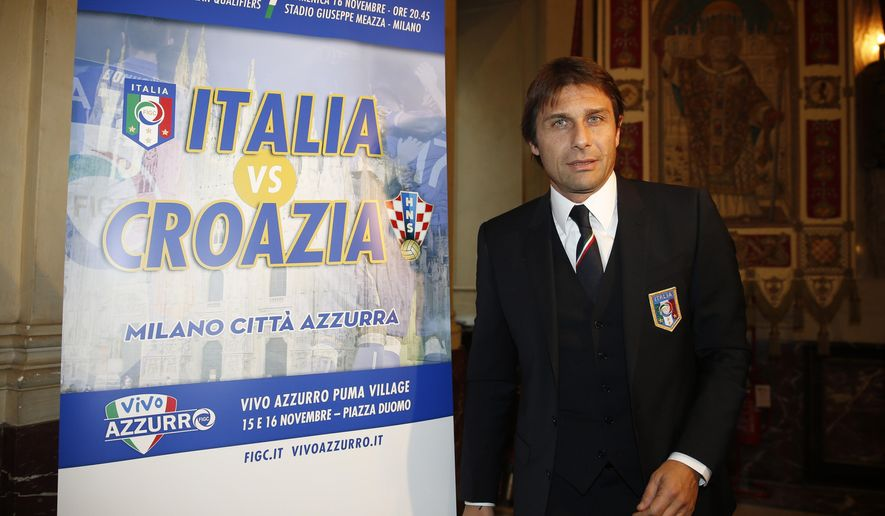 Italy's coach Antonio Conte arrives to attend a news conference to present a Group H qualifying Euro 2016 championship match between Italy and Croatia in Milan, Italy, Wednesday, Nov. 5, 2014. The match will take place on Nov. 16 at the San Siro stadium in Milan. (AP Photo/Luca Bruno)