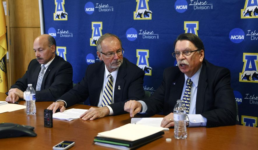 Chancellor Brian Rogers, right, speaks during a news conference with Athletic Director Gary Gray, center, and Vice Chancellor for University and Student Advancement Michael Sfraga, in the University of Alaska Fairbanks Alumni Lounge, Wednesday, Nov. 5, 2014, in Fairbanks, Alaska. The University of Alaska Fairbanks has been fined $30,000 and will not be eligible for postseason play in several sports because of NCAA infractions handed down Wednesday. (AP Photo/Fairbanks Daily News-Miner, Erin Corneliussen)