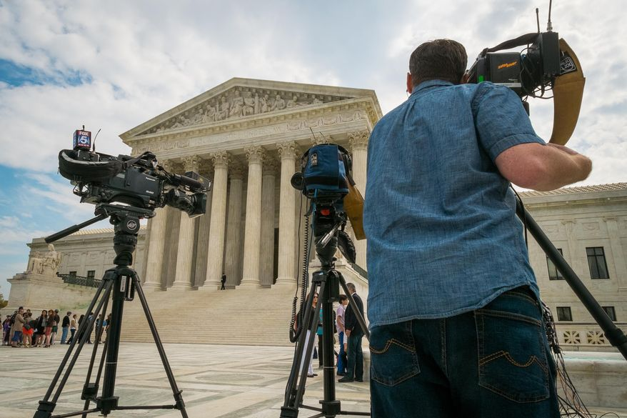 FILE - This April 22, 2104 file photo shows videojournalists setting up outside the Supreme Court in Washington.  The court heard arguments today in the case of John Yates, a fishing boat captain who claims he was wrongly convicted of destroying evidence, namely, the fish, that were under the legal minimum catch size in the Gulf of Mexico. (AP Photo/J. David Ake, File)