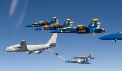 GRAND JUNCTION, Colo. (Sept. 19, 2012) F/A-18 Hornets assigned to the U.S. Navy Flight Demonstration Squadron, the Blue Angels, conduct an aerial refueling evolution with a KC-135 Stratotanker from the 97th Air Mobility Wing out of Altus Air Force Base, Okla. (U.S. Navy photo by Mass Communication Specialist 2nd Class Andrew Johnson/Released) 120919-N-BA418-023 Join the conversationwww.facebook.com/USNavywww.twitter.com/USNavynavylive.dodlive.mil