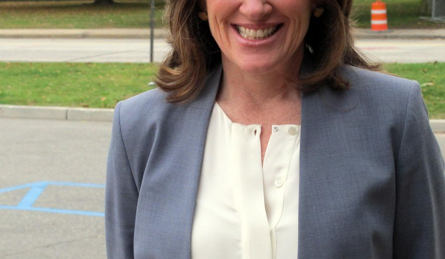 Nassau County District Attorney Kathleen Rice stands outside her campaign headquarters in Mineola, N.Y., on Wednesday, Nov. 5, 2014. Rice, a longtime suburban New York prosecutor just elected to the U.S. House of Representatives said Wednesday she would like her chief assistant to take over as acting Nassau County district attorney until a special election can be held next November.   (AP Photo/Frank Eltman)