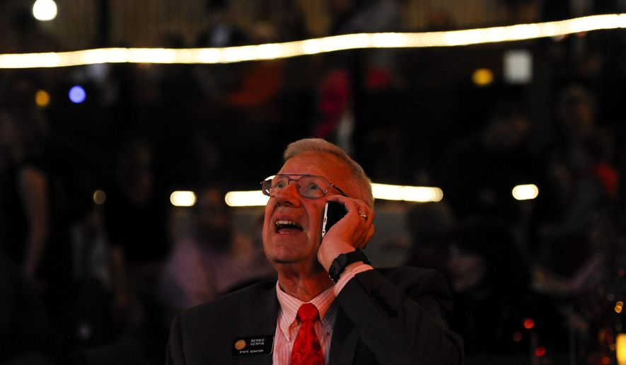 State Sen. Bernie Herpin reacts to the first election results that show him trailing democrat Mike Merrifield, Tuesday, Nov. 4, 2014, at the El Paso County Republican Party watch party at Stargazers Theater, in Colorado Springs, Colo. (AP Photo/The Colorado Springs Gazette, Michael Ciaglo)