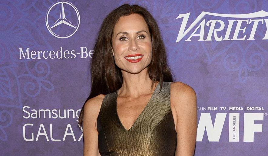 """FILE - In this Aug. 23, 2014 file photo, Minnie Driver arrives at Variety and Women in Film's pre-Emmy celebration at Gracias Madre in West Hollywood, Calif. Driver will play the character Wendy Darling as an adult in the musical, """"Peter Pan Live!"""" airing Dec. 4 on NBC. (Photo by Evan Agostini/Invision/AP, File)"""