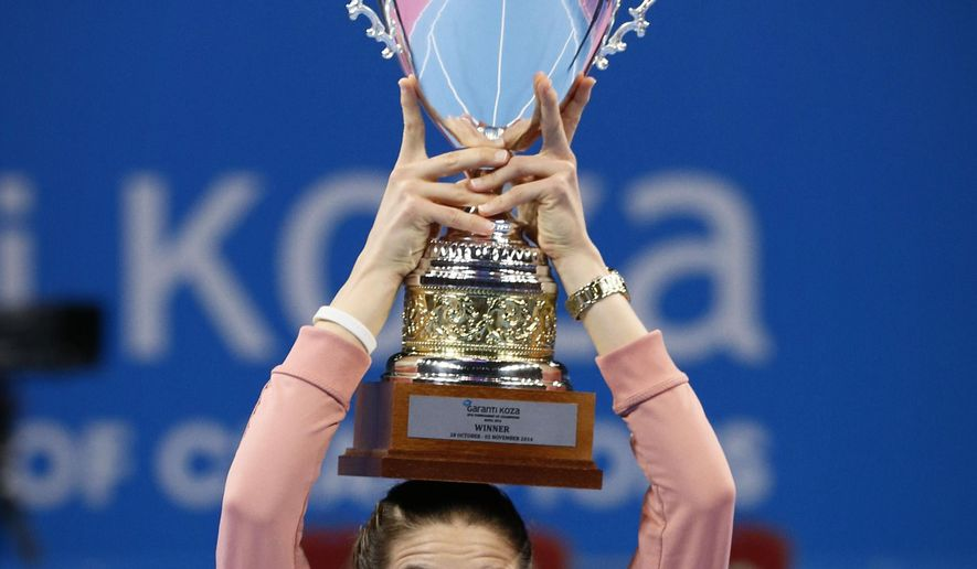 Andrea Petkovic of Germany holds up her trophy after defeating Flavia Pennetta of Italy in the final of the Garanti Koza WTA tennis tournament in Sofia, Sunday, Nov. 2 , 2014. (AP Photo)