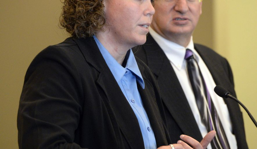 Sixth grade teacher Michelle Ferguson-Montgomery, left, whose gun accidentally went off in an elementary school bathroom, addresses the court alongside her lawyer Douglas Hoyt during a hearing in Taylorsville Justice Court Wednesday, Nov. 5, 2014, in Taylorsville, Utah. Montgomery, who has already paid $200 to replace the toilet that exploded when her handgun discharged in the faculty bathroom at Westbrook Elementary School on Sept. 11, pleaded no contest Wednesday to a misdemeanor charge of illegal discharge of a gun. It will be dismissed if she pays a $705 court fee and commits no new crimes over the next year. (AP Photo/The Salt Lake Tribune, Al Hartmann, Pool)