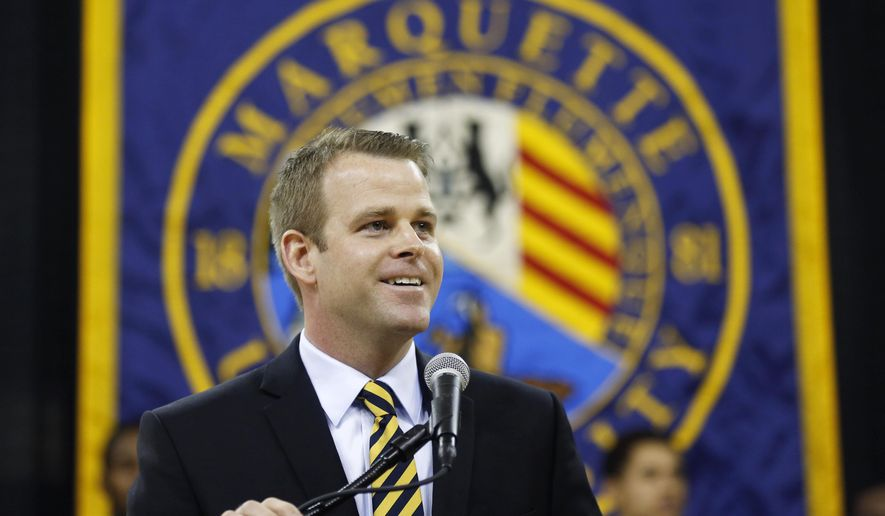 FILE - In this April 1, 2014, file photo, Steve Wojciechowski speaks as he was named coach of the Marquette University men's NCAA college basketball program in Milwaukee. (AP Photo/Jeffrey Phelps, File)