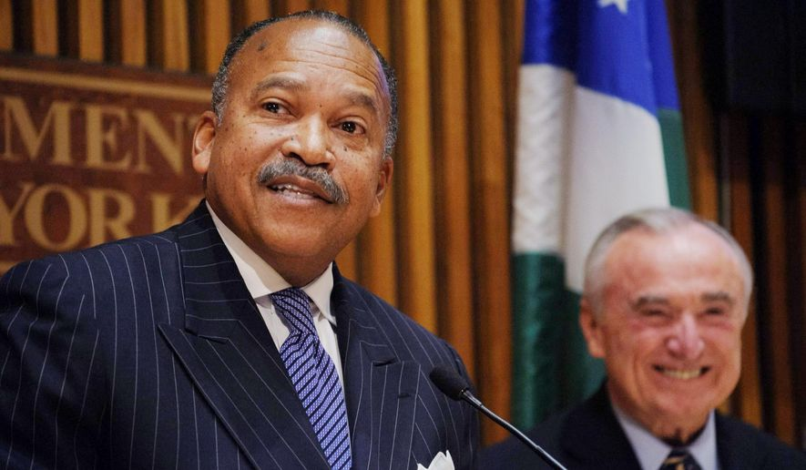 Benjamin Tucker, left, newly appointed first deputy commissioner for the New York Police Department, smiles from the stage after being introduced to the media by New York Police Commissioner William J. Bratton, right, during a news conference at NYPD headquarters in New York, Wednesday, Nov. 5, 2014. Tucker was named to the post after Chief Philip Banks III retired last week. Banks had been chief of department and was to be promoted, but quit instead. (AP Photo/Newsday, Charles Eckert) MANDATORY CREDIT, NYC OUT, MAGS OUT, NO SALES