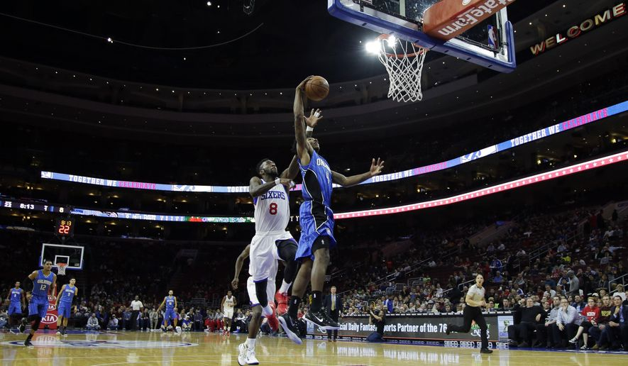 Orlando Magic's Elfrid Payton (4) goes up for a shot against Philadelphia 76ers' Tony Wroten (8) during the first half of an NBA basketball game, Wednesday, Nov. 5, 2014, in Philadelphia. (AP Photo/Matt Slocum)
