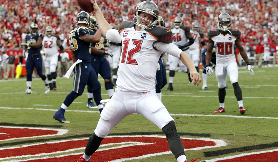 FILE - In this Sept. 14, 2014, file photo, Tampa Bay Buccaneers quarterback Josh McCown spikes the football after scoring on a 5-yard touchdown run against the St. Louis Rams during an NFL football game in Tampa, Fla. Hoping to spark one of the NFL's least productive offenses, the Buccaneers are turning back to McCown at quarterback.The 12th-year pro started the first three games of the season, but has missed the past five after injuring the thumb on his throwing hand. (AP Photo/Brian Blanco, File)