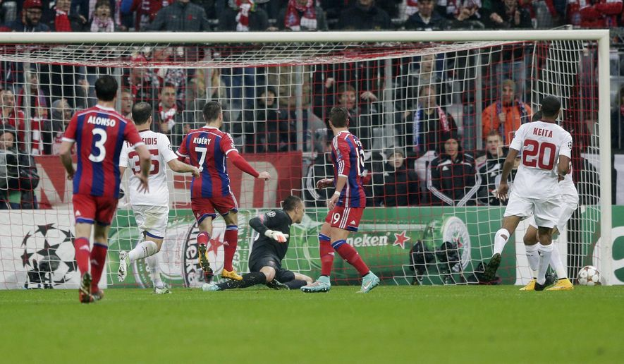 Bayern's Franck Ribery, third from left, scores his side's opening goal during the Champions League Group E soccer match between FC Bayern Munich and AS Roma at Allianz Arena in Munich, southern Germany, Wednesday Nov. 5, 2014. (AP Photo/Matthias Schrader)