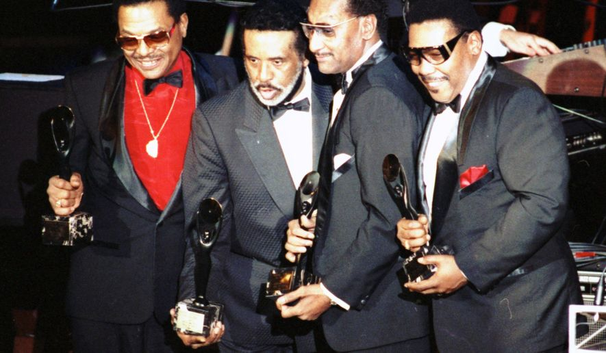 """FILE- In this Jan. 1990 file photo, the Four Tops, from left, Renaldo """"Obie"""" Benson; Levi Stubbs; Abdul """"Duke"""" Fakir, and Lawrence Payton in New York. Surviving members of The Four Tops and The Temptations will play the Palace Theatre together for seven shows between Dec. 29-Jan. 4. Tickets from $52-$142 go on sale Nov. 14. (AP Photo/Ron Frehm, File)"""