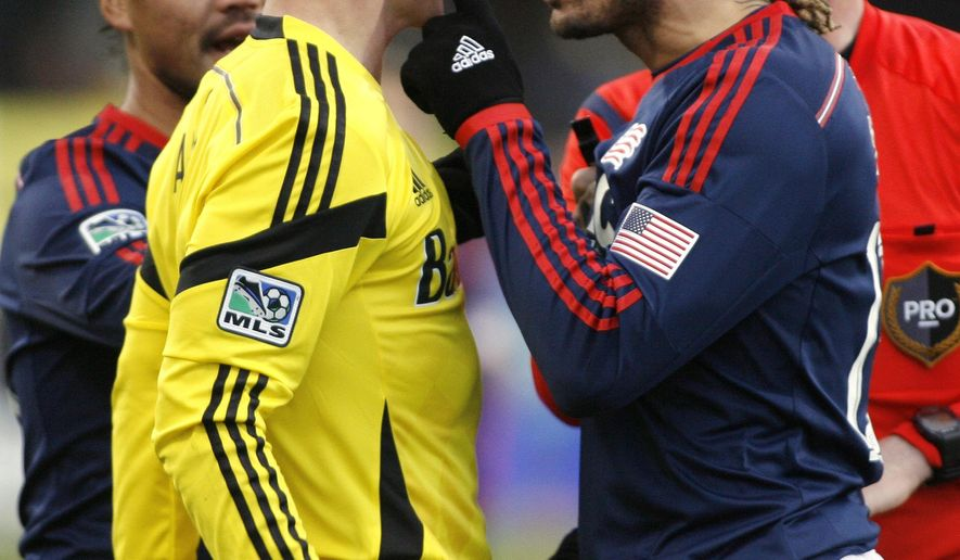 Things get heated between Columbus Crews' Bernardo Anor (7), left, and New England Revolutions' Jermaine Jones (13) during the second half of their MLS Cup playoff game, Saturday, Nov. 1, 2014, in Columbus, Ohio. New England won 4-2. (AP Photo/Mike Munden)
