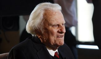 In this Dec. 20, 2010, file photo, the Rev. Billy Graham is interviewed at the Billy Graham Evangelistic Association headquarters in Charlotte, N.C. Graham plans to celebrate his 96th birthday, on Friday, Nov. 7, 2014, with family and friends. Last year, 900 people attended a two-hour party for Graham at an Asheville hotel. His son, the Rev. Franklin Graham, said Wednesday that his father is in good spirits, he's eating well, and his mind is still sharp. (AP Photo/Nell Redmond, File)