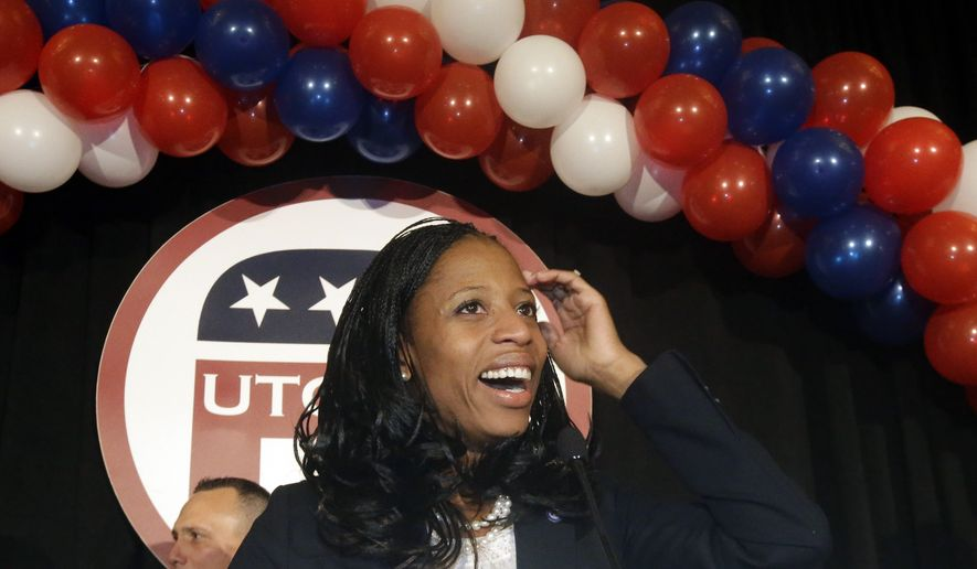 Republican Mia Love celebrates with her supporters after winning the race for Utah's 4th Congressional District during a GOP election night watch party Tuesday, Nov. 4, 2014, in Salt Lake City. (AP Photo/Rick Bowmer)
