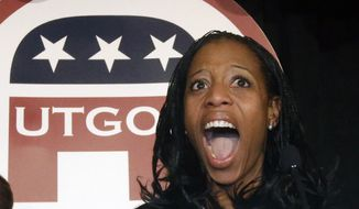 Republican Mia Love celebrates after winning the race for Utah's 4th Congressional District during a GOP election night watch party Tuesday, Nov. 4, 2014, in Salt Lake City. (AP Photo/Rick Bowmer)