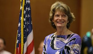 U.S. Sen. Lisa Murkowski, R-Alaska stands on stage at an election-night rally for Republican U.S. Senate candidate Dan Sullivan, Tuesday, Nov. 4, 2014, in Anchorage Alaska. Sullivan is challenging U.S. Sen. Mark Begich, D-Alaska. (AP Photo/Ted S. Warren) **FILE**