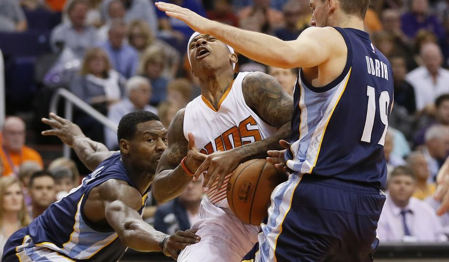 Phoenix Suns guard Isaiah Thomas (3) is fouled by Memphis Grizzlies guard Beno Udrih (19), of Slovenia, during the second half of an NBA basketball game, Wednesday, Nov. 5, 2014, in Phoenix. The Grizzlies won 102-91. (AP Photo/Matt York)