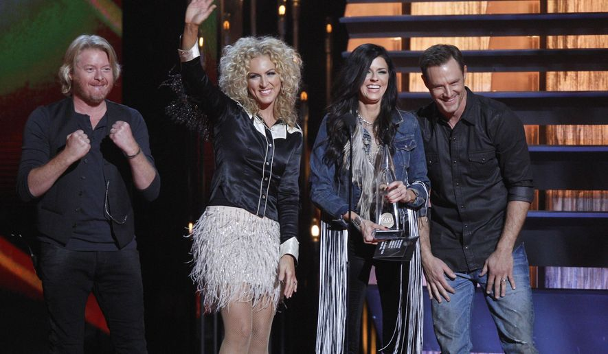 Phillip Sweet, from left, Kimberly Schlapman, Karen Fairchild and Jimi Westbrook, of the musical group Little Big Town, accept the vocal group of the year award at the 48th annual CMA Awards at the Bridgestone Arena on Wednesday, Nov. 5, 2014, in Nashville, Tenn. (Photo by Wade Payne/Invision/AP)