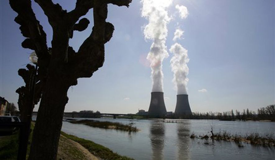The Belleville-sur-Loire's nuclear plant, across the Loire river, central France, March 27, 2007. (Associated Press) ** FILE **
