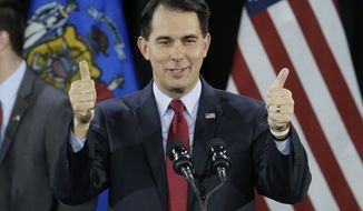Wisconsin Republican Gov. Scott Walker gives a thumbs up as he speaks at his campaign party Tuesday, Nov. 4, 2014, in West Allis, Wis. Walker defeated Democratic gubernatorial challenger Mary Burke. (AP Photo/Morry Gash)