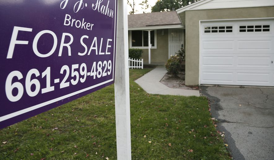 This Monday, Nov. 3, 2014 photo shows a house for sale in Los Angeles. Freddie Mac, the mortgage company, releases weekly mortgage rates on Thursday, Nov. 6, 2014. (AP Photo/Richard Vogel)