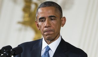 """President Barack Obama pauses during a news conference in the East Room of the White House, on Wednesday, Nov. 5, 2014, in Washington. Obama is telling Americans who voted for change: """"I hear you."""" The President said the Republican victories Tuesday in the midterm elections are a sign they want Washington """"to get the job done.""""  (AP Photo/Evan Vucci)"""
