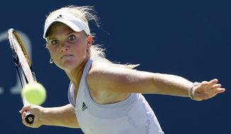 FILE - In this Sept. 3, 2009, file photo, Melanie Oudin, of the United States, returns to Elena Dementieva, of Russia, during the second round of the U.S. Open tennis tournament in New York. American tennis pro Melanie Oudin says she will have a procedure Thursday, Nov. 6, 2014 for a heart condition, and surgery later this month for an eye problem. (AP Photo/Kathy Willens, File)