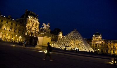 A walker ambles past the Louvre on a clear Paris evening -- no backpack to carry and money safe in front pocket. (Photo courtesy Ilene Perlman.)