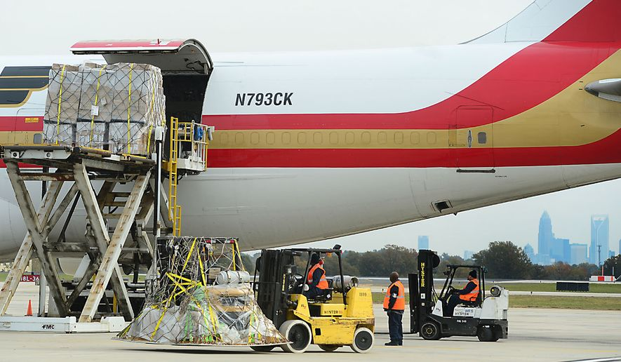 Workers load a cargo jet with tons of Ebola relief supplies at Charlotte Douglas International Airport in Charlotte, N.C., on Nov. 5, 2014. The International Christian charity Samaritaan's Purse is shipping the supplies to Liberia. (Associated Press/The Charlotte Observer, Todd Sumlin) **FILE**