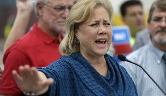 Sen. Mary Landrieu, D-La., speaks to reporters, surrounded by supporters, in front of the New Orleans VA Hospital construction site, the day after being forced into a runoff against her main challenger, Rep. Paul Cassidy, R-La., in New Orleans, Wednesday, Nov. 5, 2014. (AP Photo/Gerald Herbert)