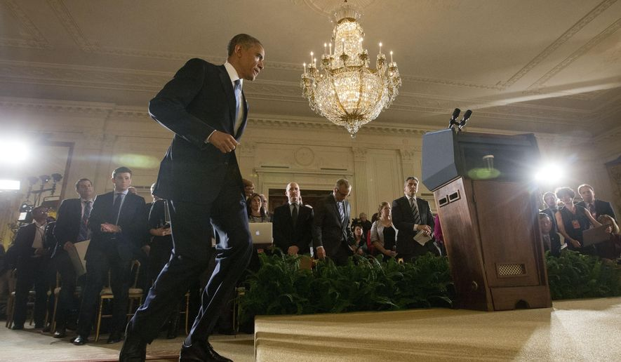 President Barack Obama walks in for the start of his news conference in the East Room of the White House, on Wednesday, Nov. 5, 2014, in Washington.  (AP Photo/Pablo Martinez Monsivais)