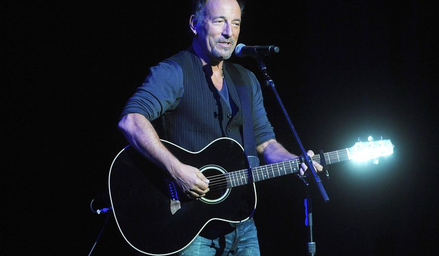Bruce Springsteen performs at the 8th Annual Stand Up For Heroes, presented by New York Comedy Festival and The Bob Woodruff Foundation, at the Theater at Madison Square Garden on Wednesday, Nov. 5, 2014, in New York. (Photo by Brad Barket/Invision/AP)