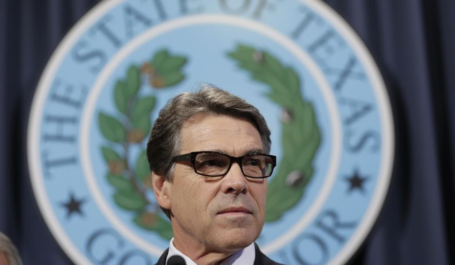 Texas Gov. Rick Perry speaks during a news conference in Austin, Texas, in this Oct. 17, 2014, file photo. (AP Photo/Eric Gay, File)
