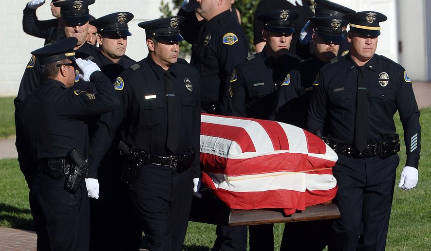 The body of slain Pomona police officer Shaun Diamond is carried to a waiting hearse by fellow officers prior to being escorted from Forest Lawn in Covina, Calif., to Citizens Business Bank Arena in Ontario, for funeral services Thursday morning, Nov. 6, 2014. Authorities say Diamond was shot Oct. 28 in San Gabriel during a multi-agency operation focused on the Mongols motorcycle gang. The 15-year law enforcement veteran died a day later. (AP Photo/The Inland Valley Daily Bulletin, Will Lester)  MANDATORY CREDIT